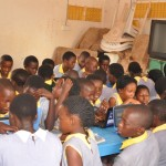 Students of Vincent Alex during a computer lesson